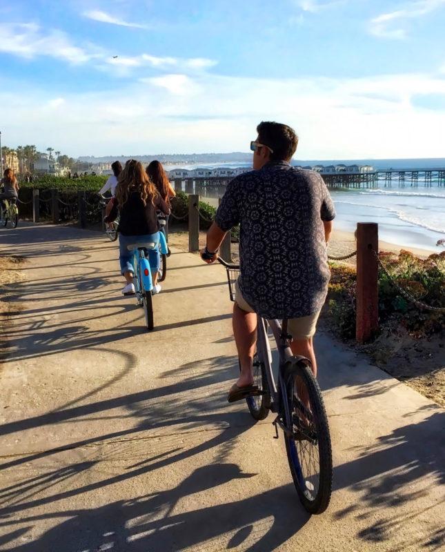 biking in pacific beach san diego ocean in background